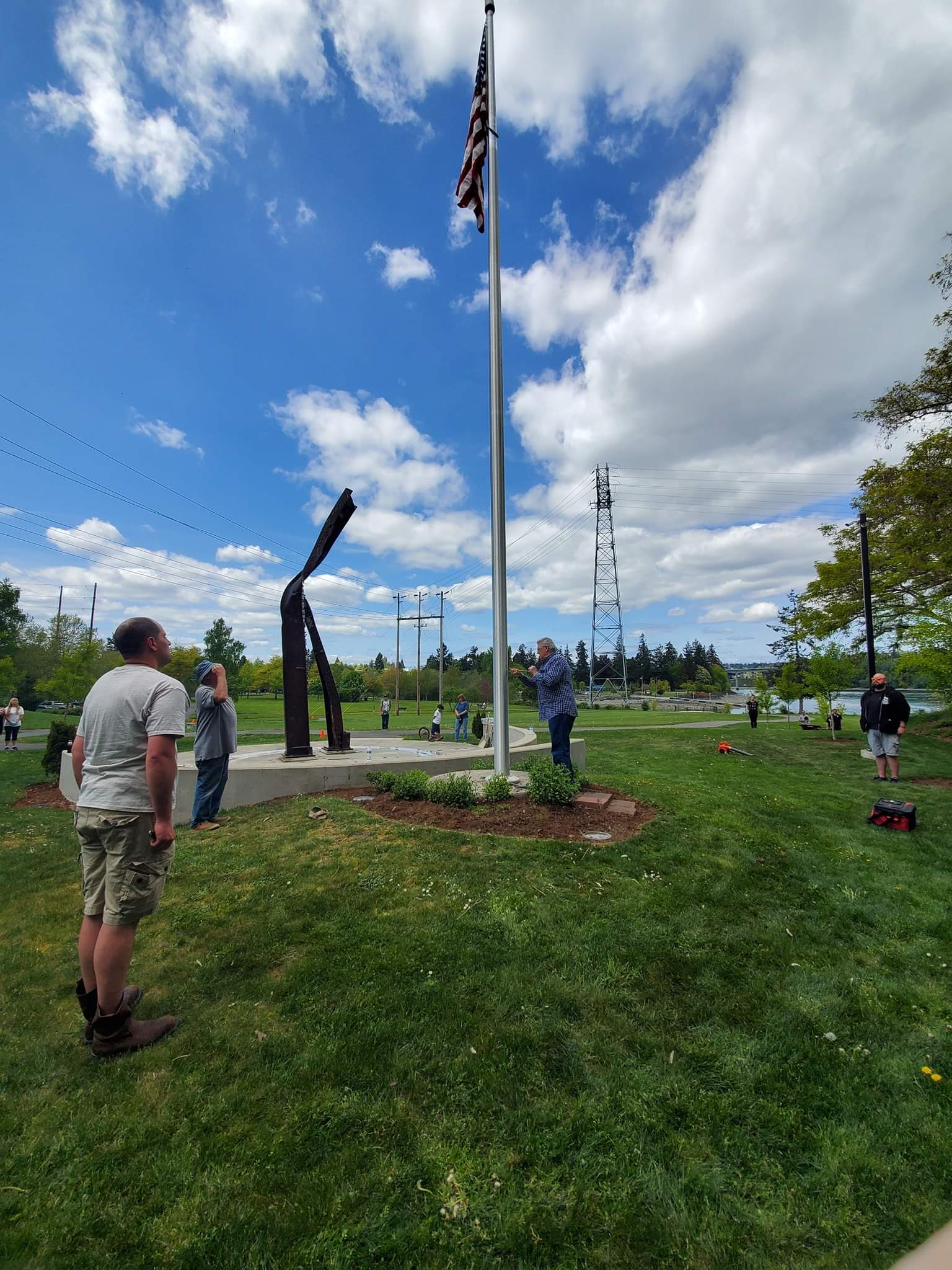 Work stopped for the retiring of the colors. Here all the volunteers stand and show respect as the new flag is flown.