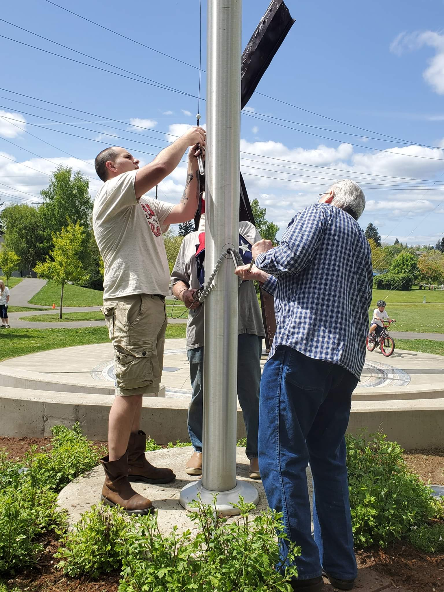 Volunteers retire the colors, to be replaced with a new flag.