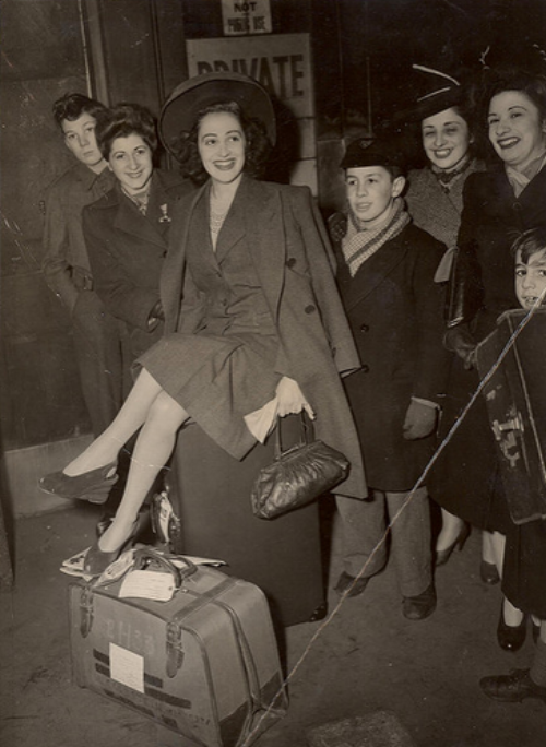 War-era woman wearing a suit (Flickr Commons)