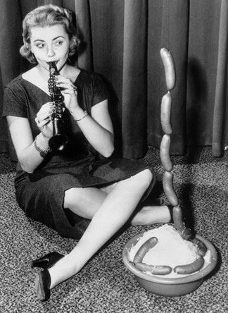 And speaking of blowing, Illinois' 1956 Miss Universe contestant certainly has nailed her talent segment.