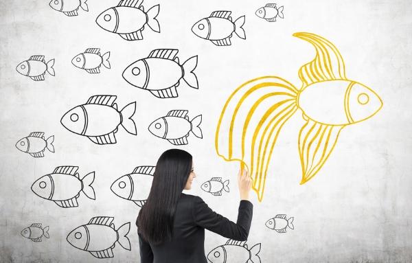 Businesswoman drawing goldfish