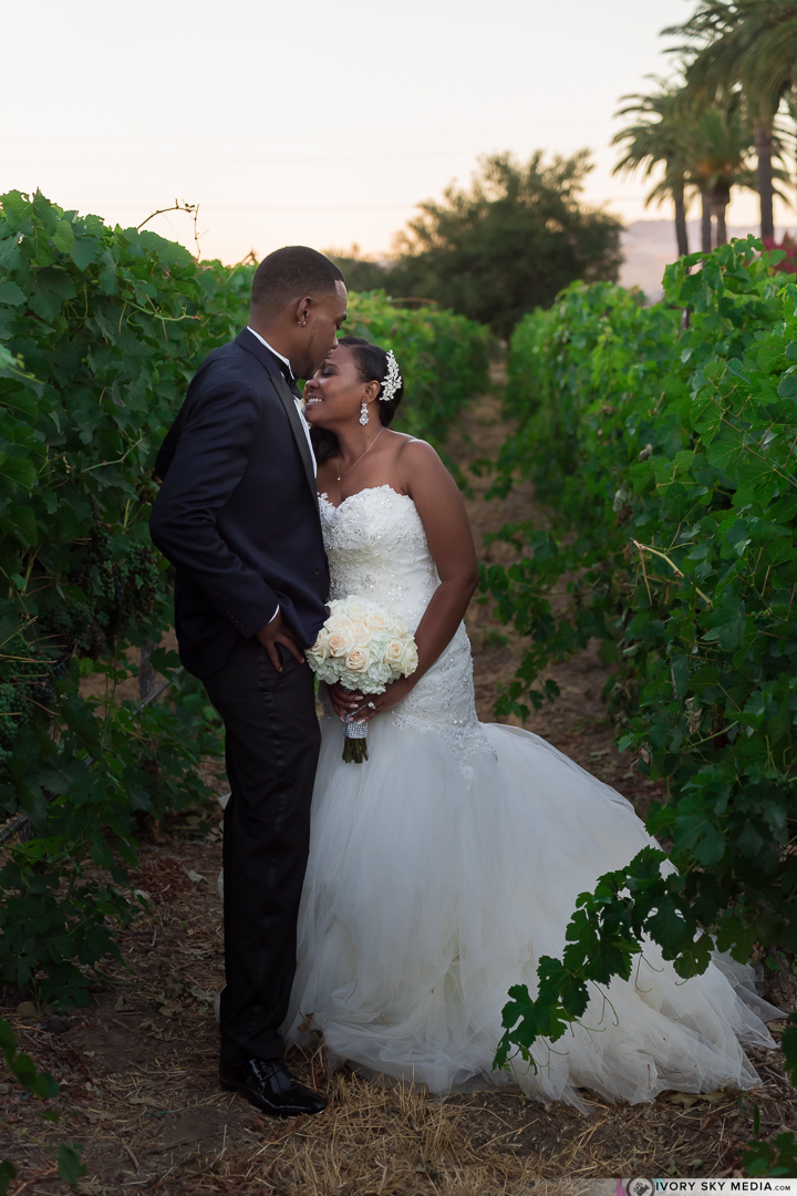 The lovely couple shared a private moment in the vineyard.
