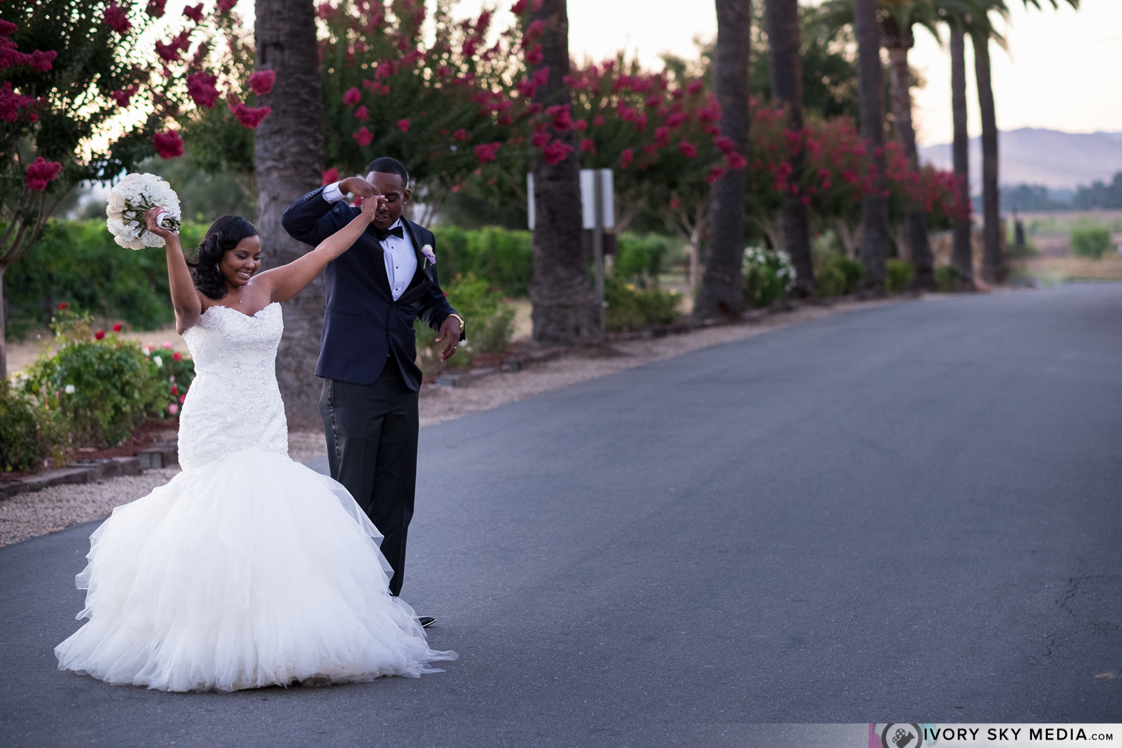 Dancing outside their vineyard wedding venue, while guest anticipate their grand entrance.