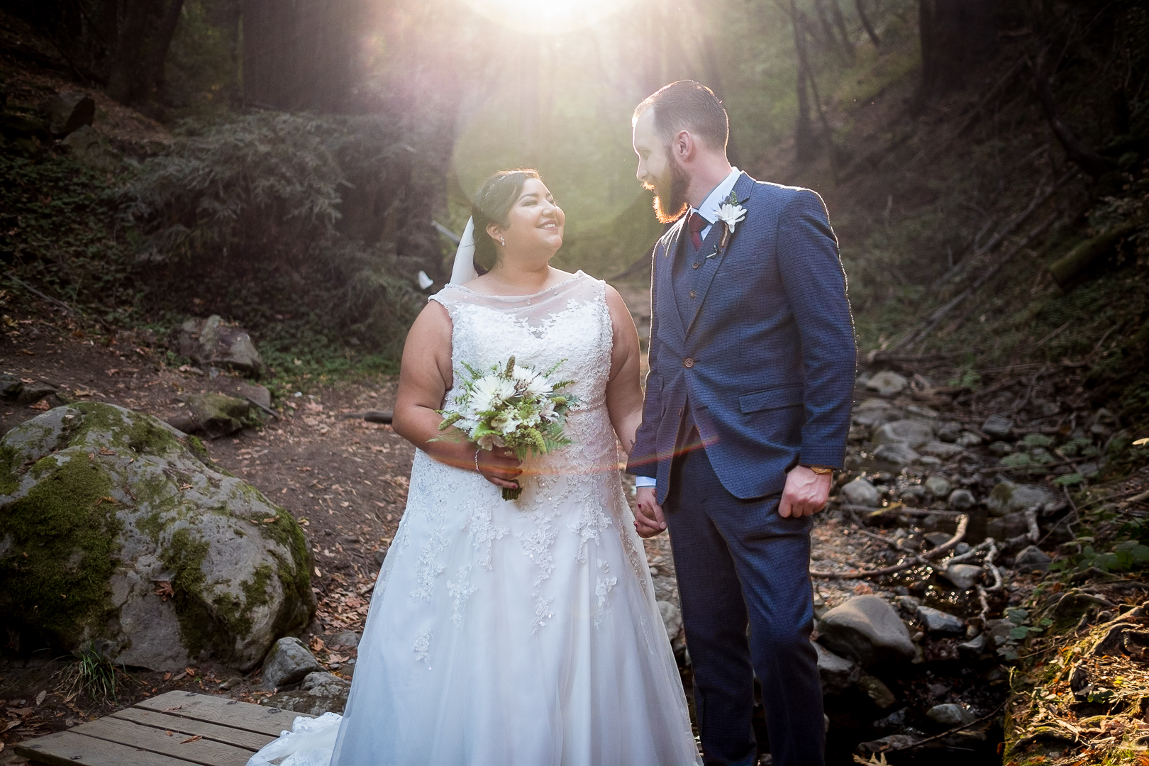 Beautiful sun flare over the lovely couple.