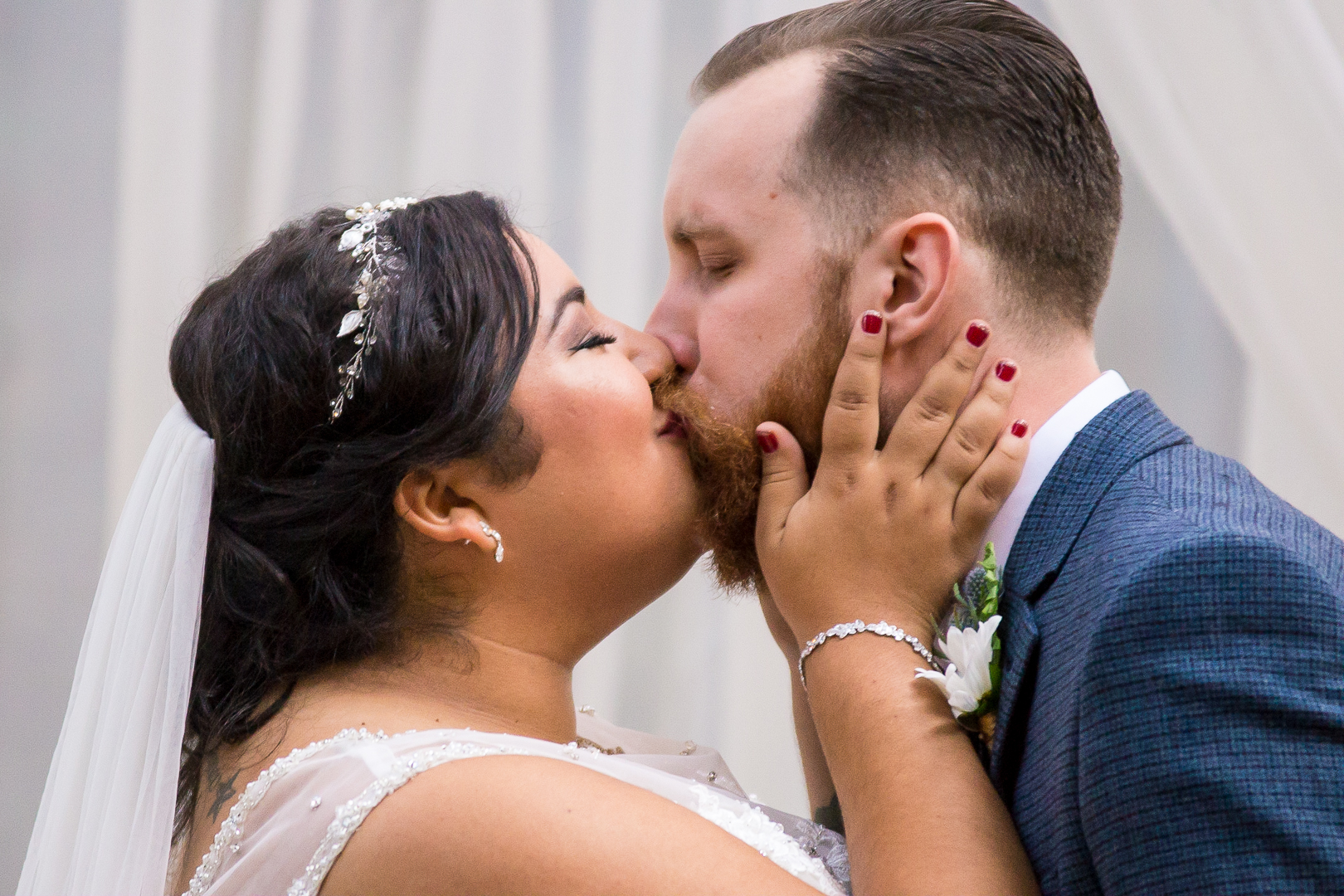 The Bride and Groom's first kiss.