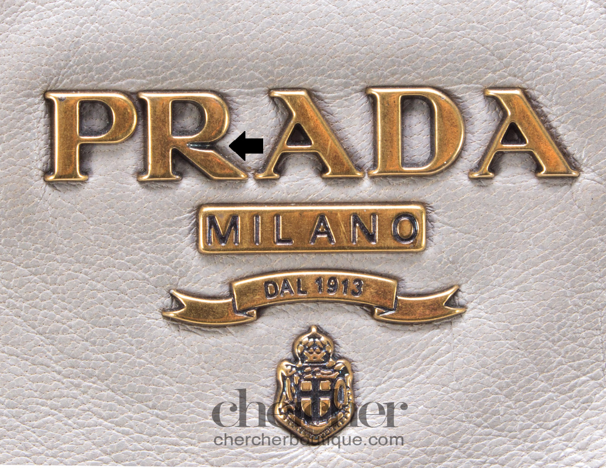 Many authentication guides claim that the 'R' of the Prada logo should always have a notch to its right leg.