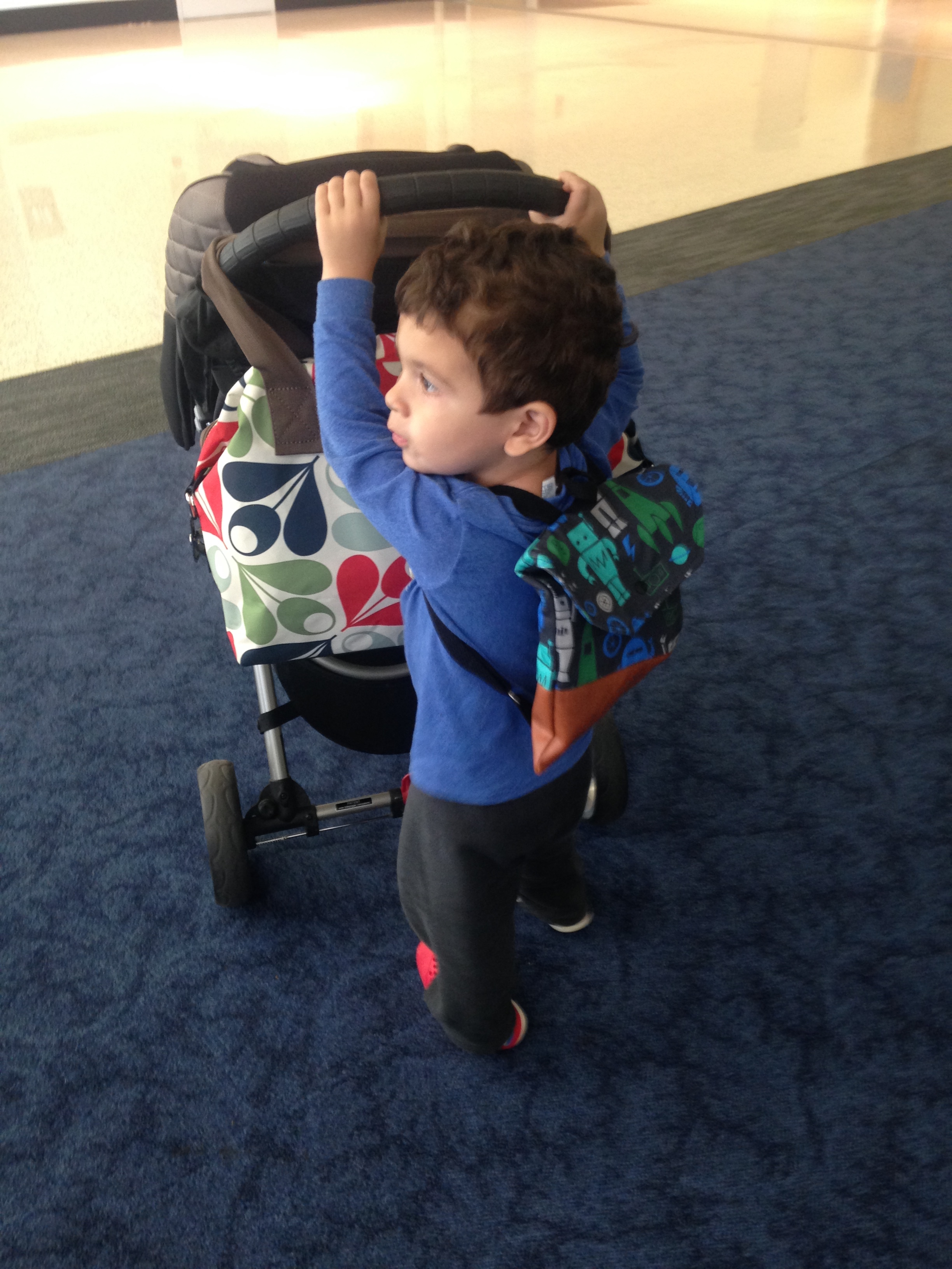 A good travel helper pushes the stroller.