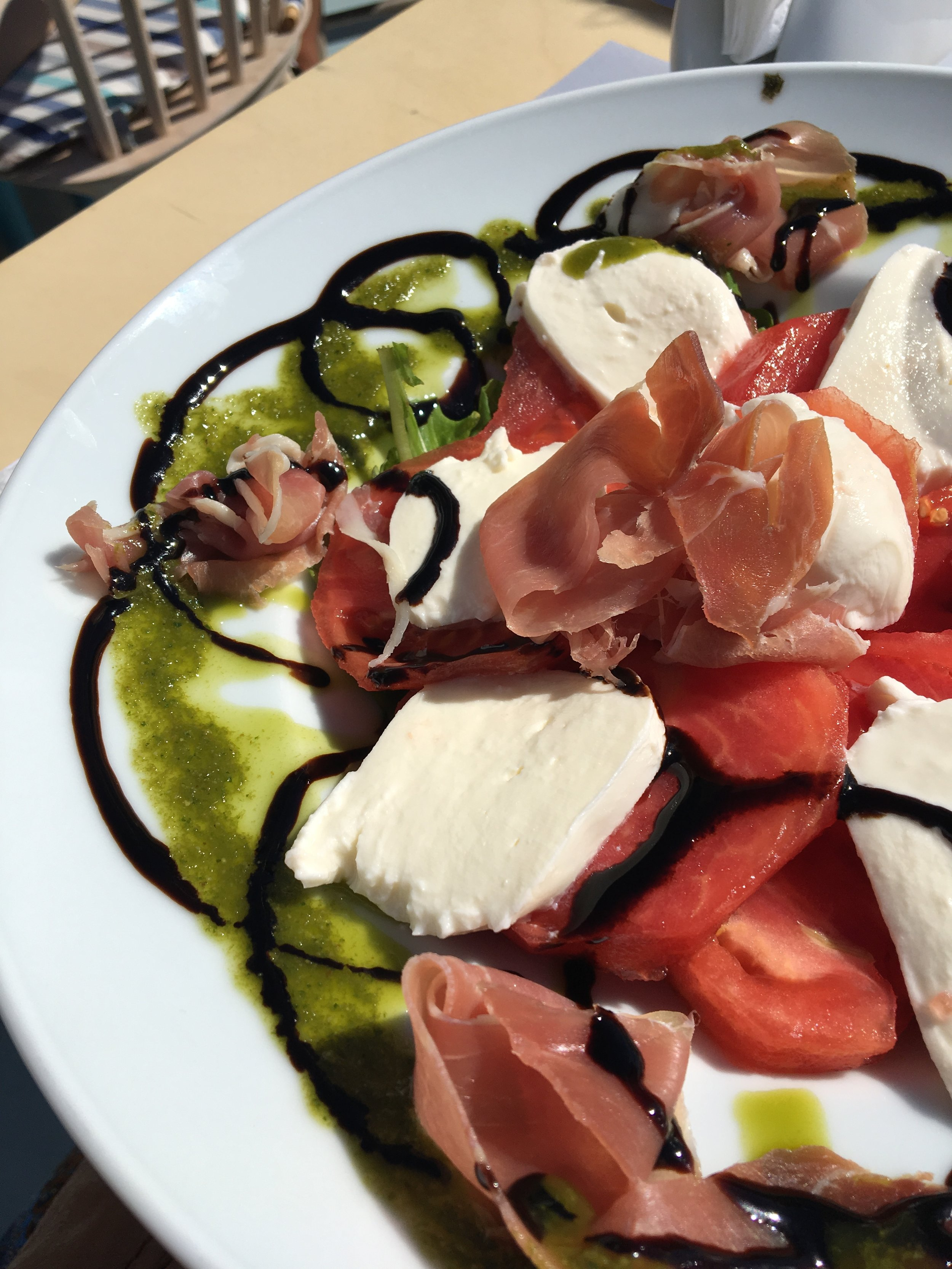 To this delicious caprese salad I ate in Santorini, Greece: I love you.