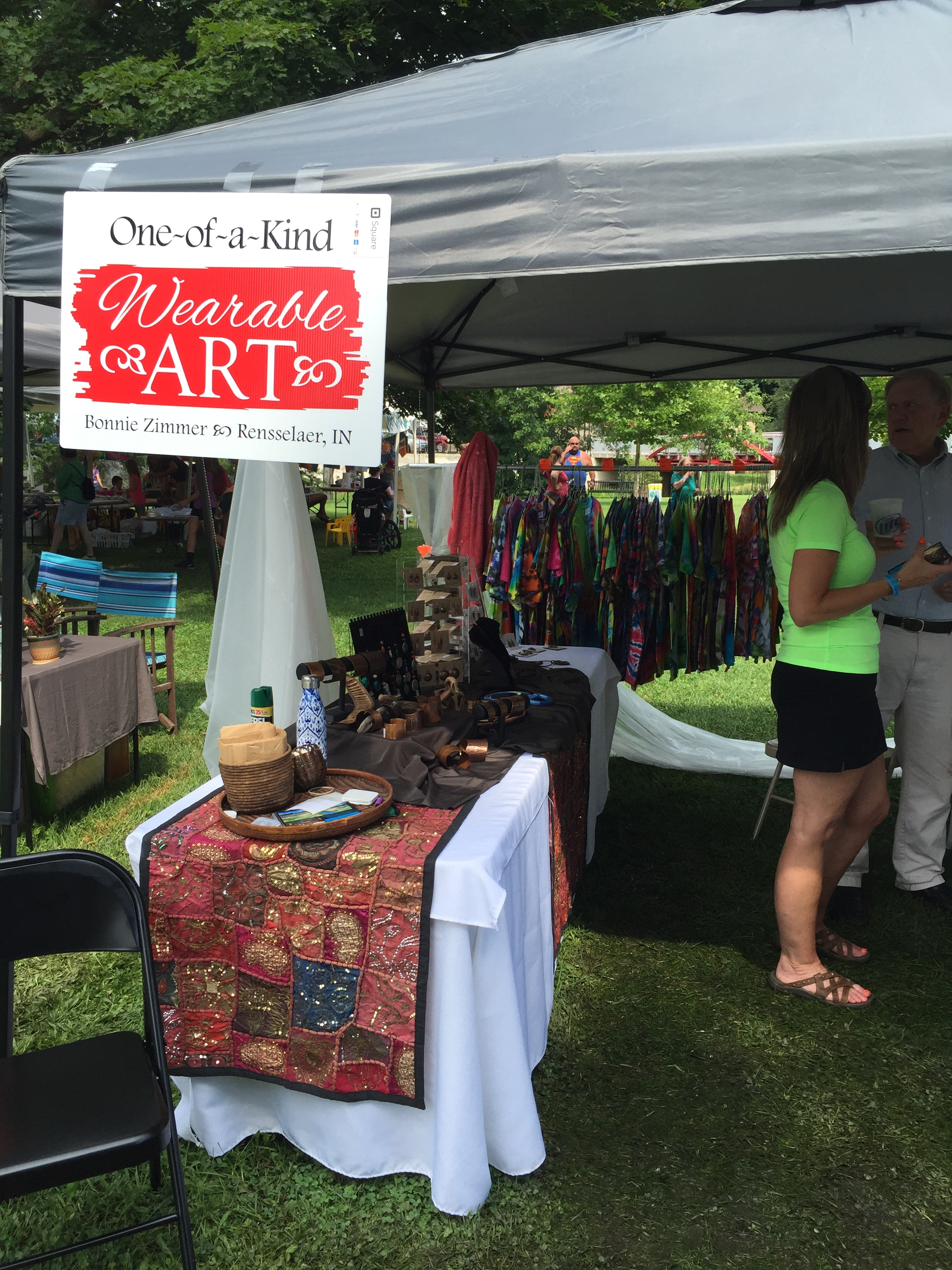 """A snapshot of my booth, selling my """"hobby art"""", copper,porcelain and mixed media jewelry and tie-dye shirts."""