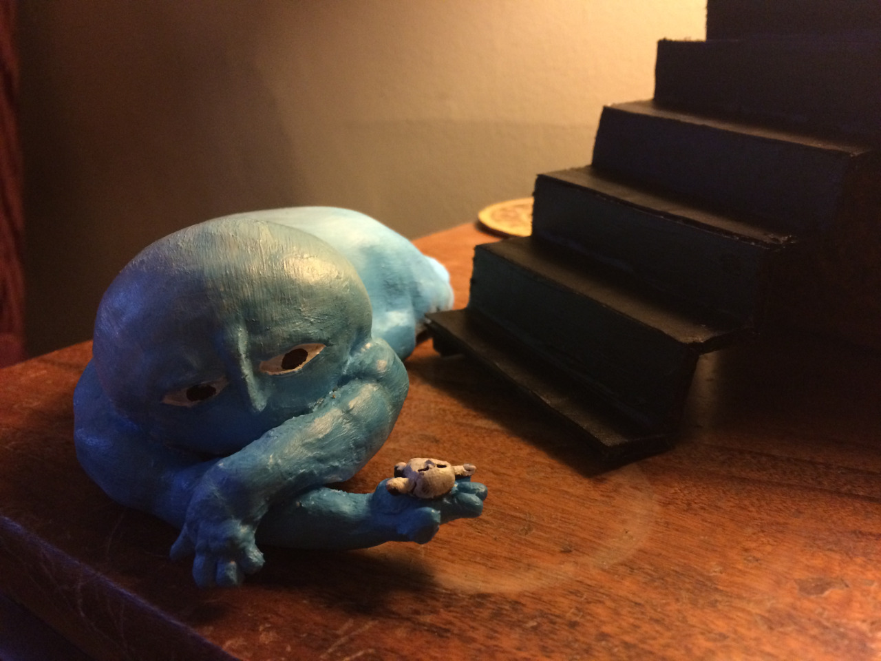 Milo is blue, well he is kinda sad, but blue?!?! I think he will change colors sometimes but mostly be white. He's a little freaked out after falling down the stairs and finding himself in the palm of his hand.
