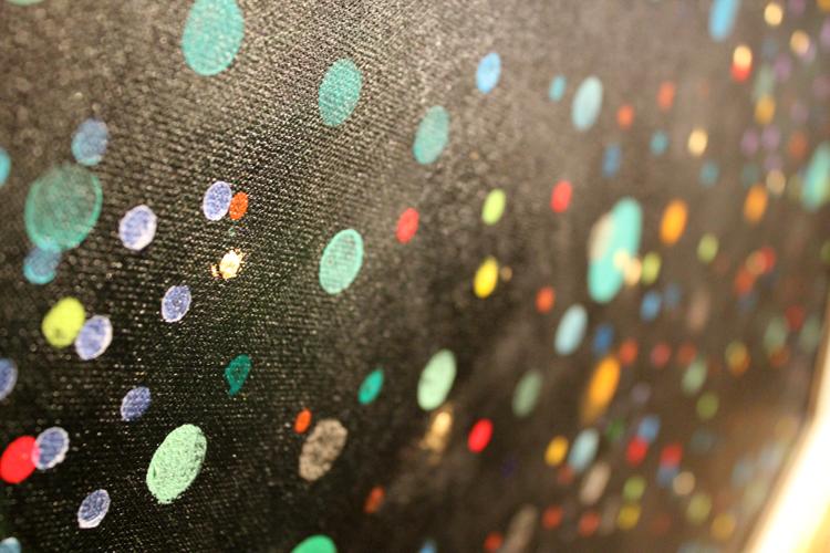 Detail of gold dot on Listen