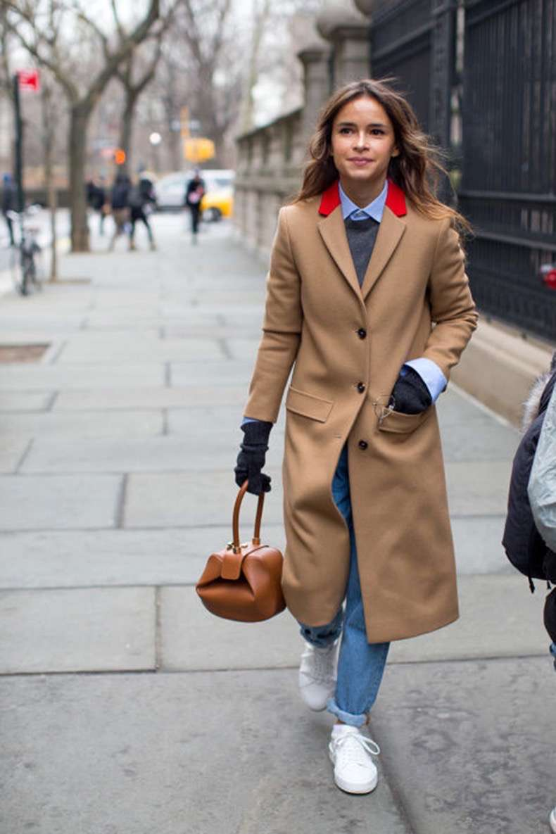 winter-work-outfit-rolled-jeans-white-sneakers-colored-shirt-sweater-over-oxford-shirt-camel-coat-miroslava-duma-brunch-weekend-winter-outfits-nyfw-street-style-2016-hbz.jpg
