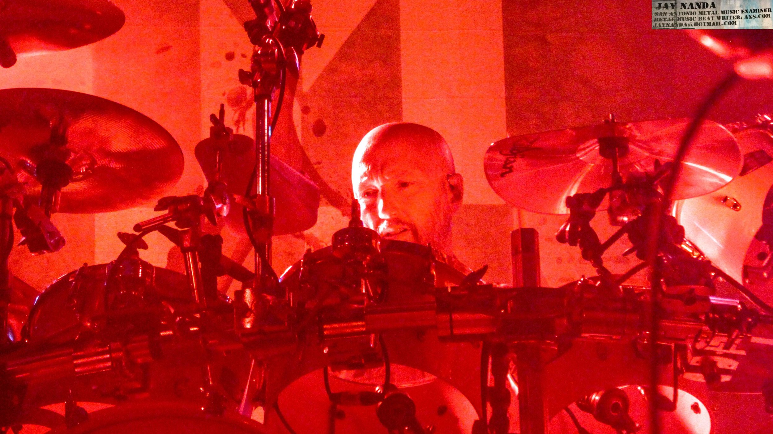 McClain drums in a sea of red.