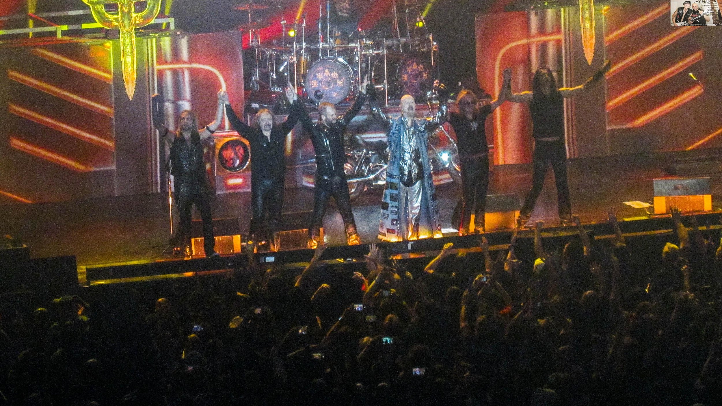 """From left: Faulkner, Hill, Sneap, Halford, Tipton and Travis acknowledge the cheers following finale """"Living After Midnight."""""""