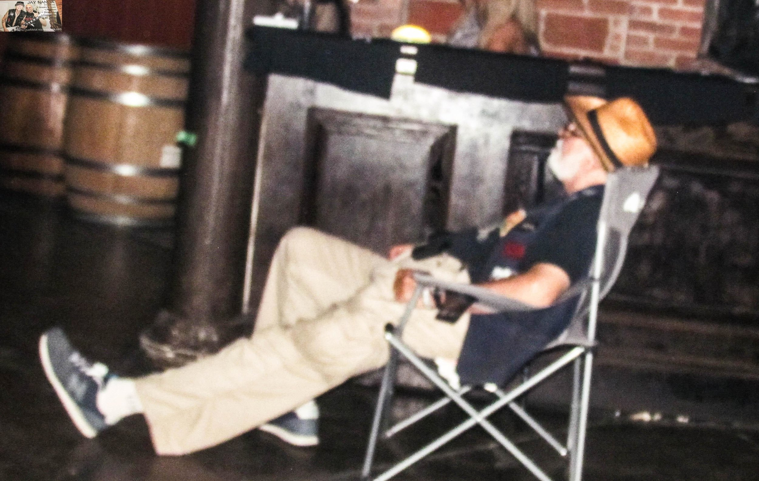 Not only was this elderly man NOT sleeping in his chair, but he was one of the few patrons who was at the Memorial Day Metalfest both days; here he's relaxing while taking in San Diego band Symbolic.