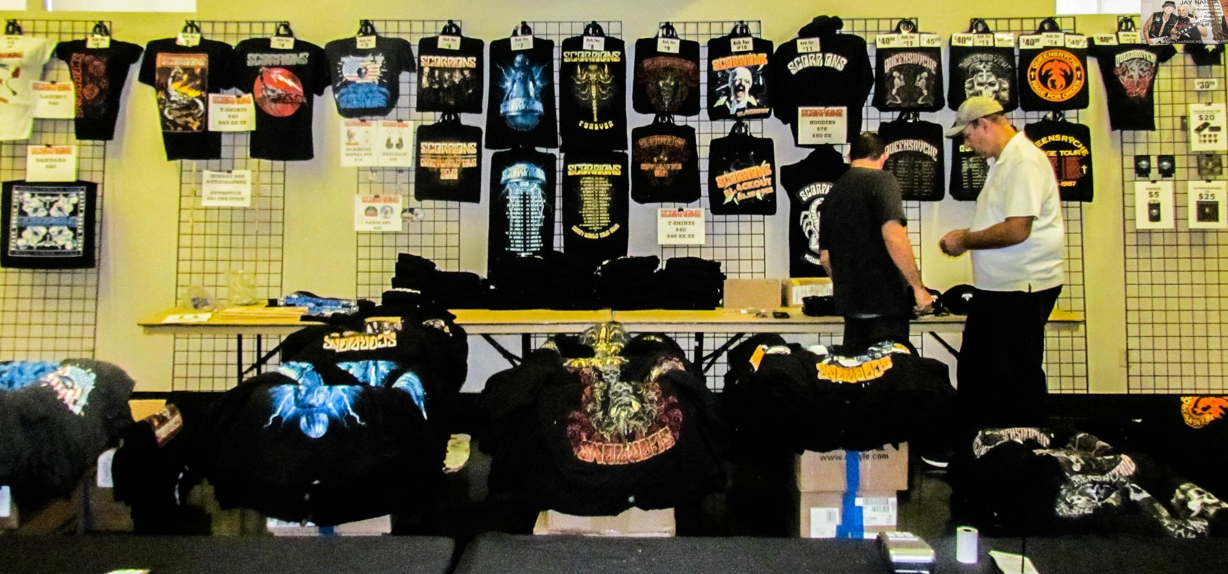 The merch booth displays the shirts, hats and other products of Scorpions and Queensryche.