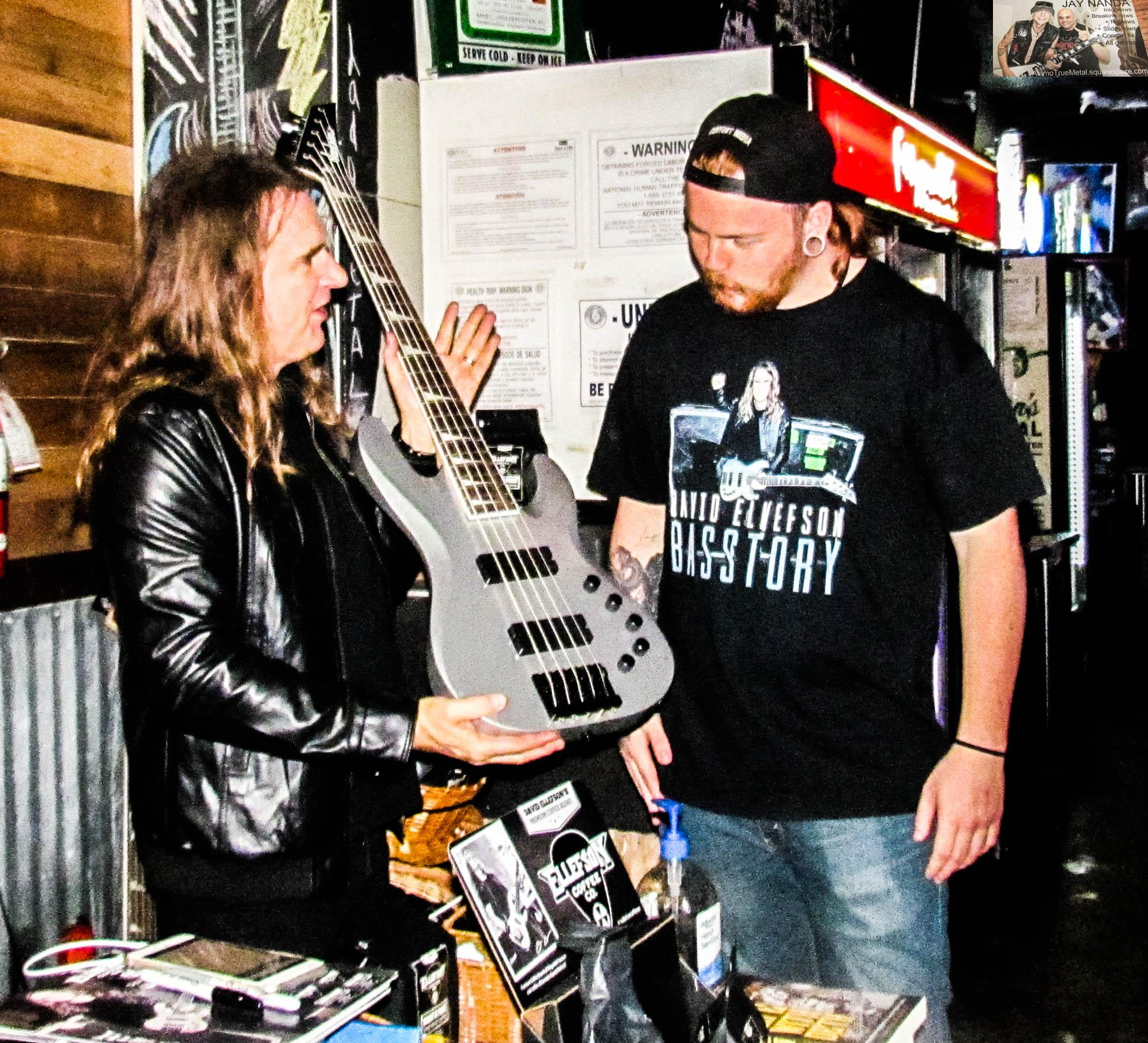 Ellefson hands off one of the basses he played to a dedicated fan.