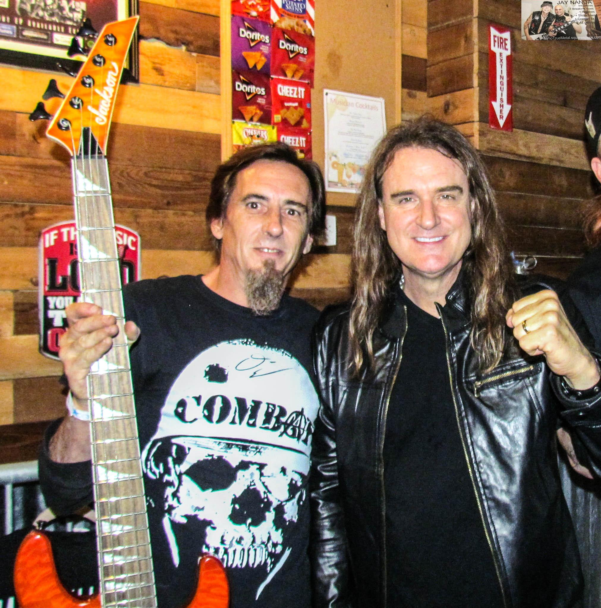 Local fan and disc jockey Brian Keith gladly accepts Ellefson's signature orange bass.