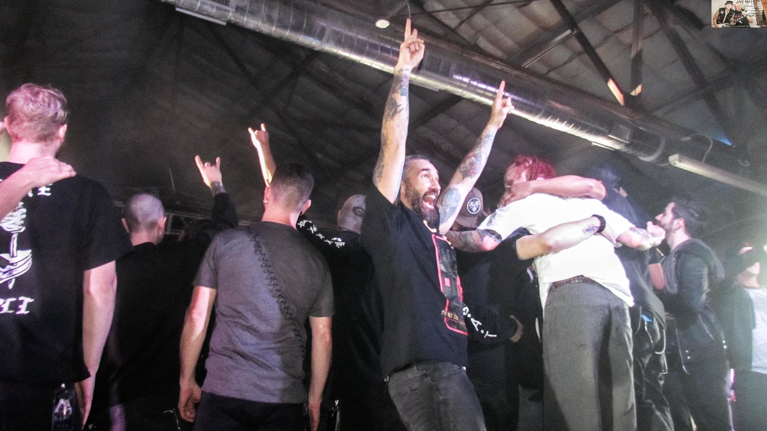 As the artists get lined up for a tour-ending picture, Sevendust guitarist Clint Lowery turns one last time toward the crowd.