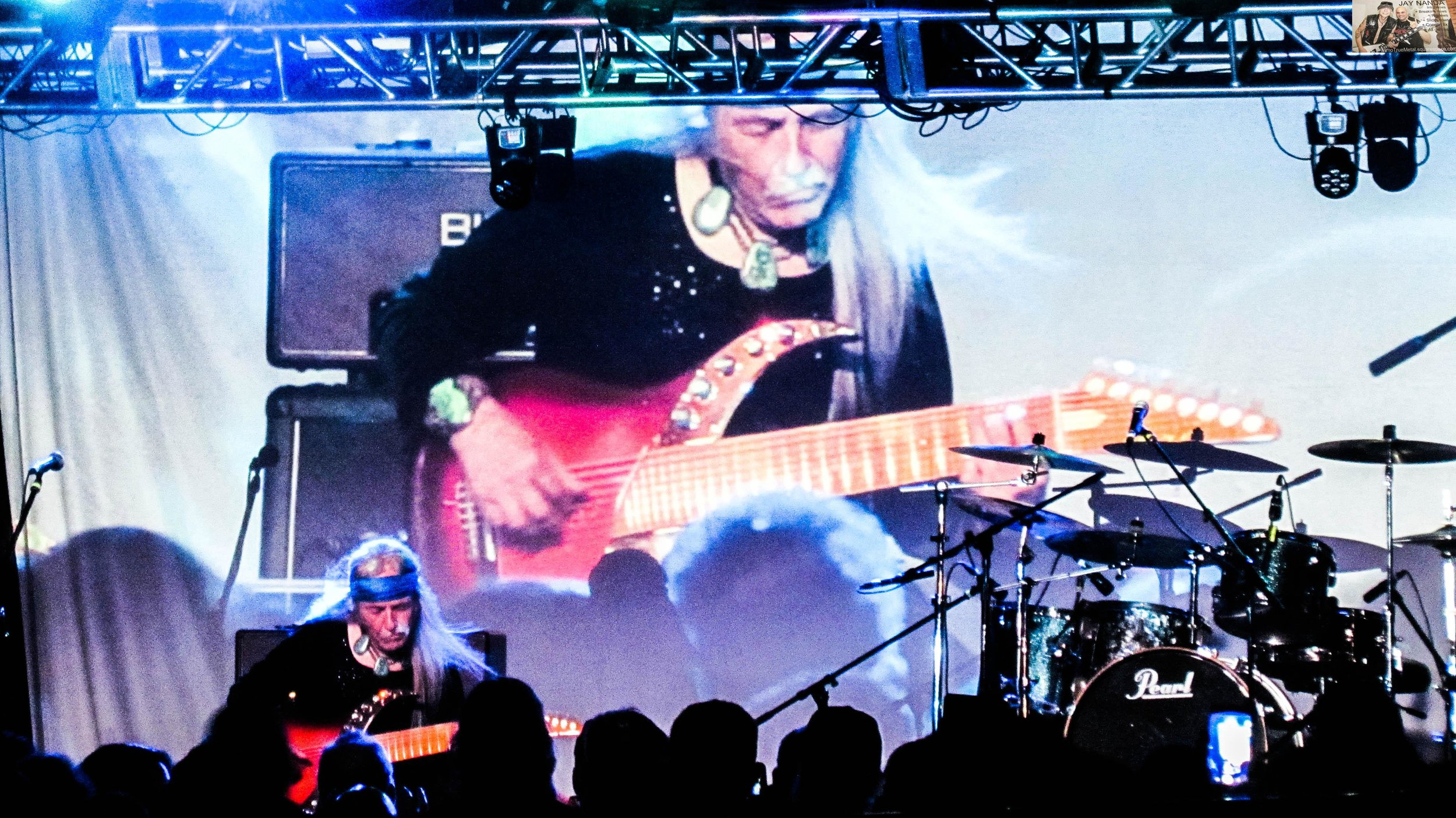 """Roth asked the crowd for silence as he went solo for """"Passage to India,"""" saying, """"I don't mind if you talk during the heavy stuff"""" but that this tune was quieter than normal."""