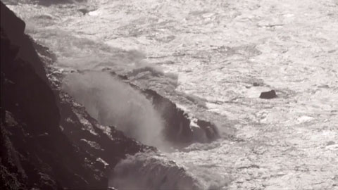 Ocean waves crashing into the Byron Bay cliffs - Angus Stone Guiness Arthur's Day Film production Toby heslop