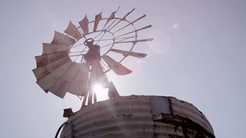 Sun poking through a windmill - Angus Stone Guiness Arthur's Day Film production Toby heslop