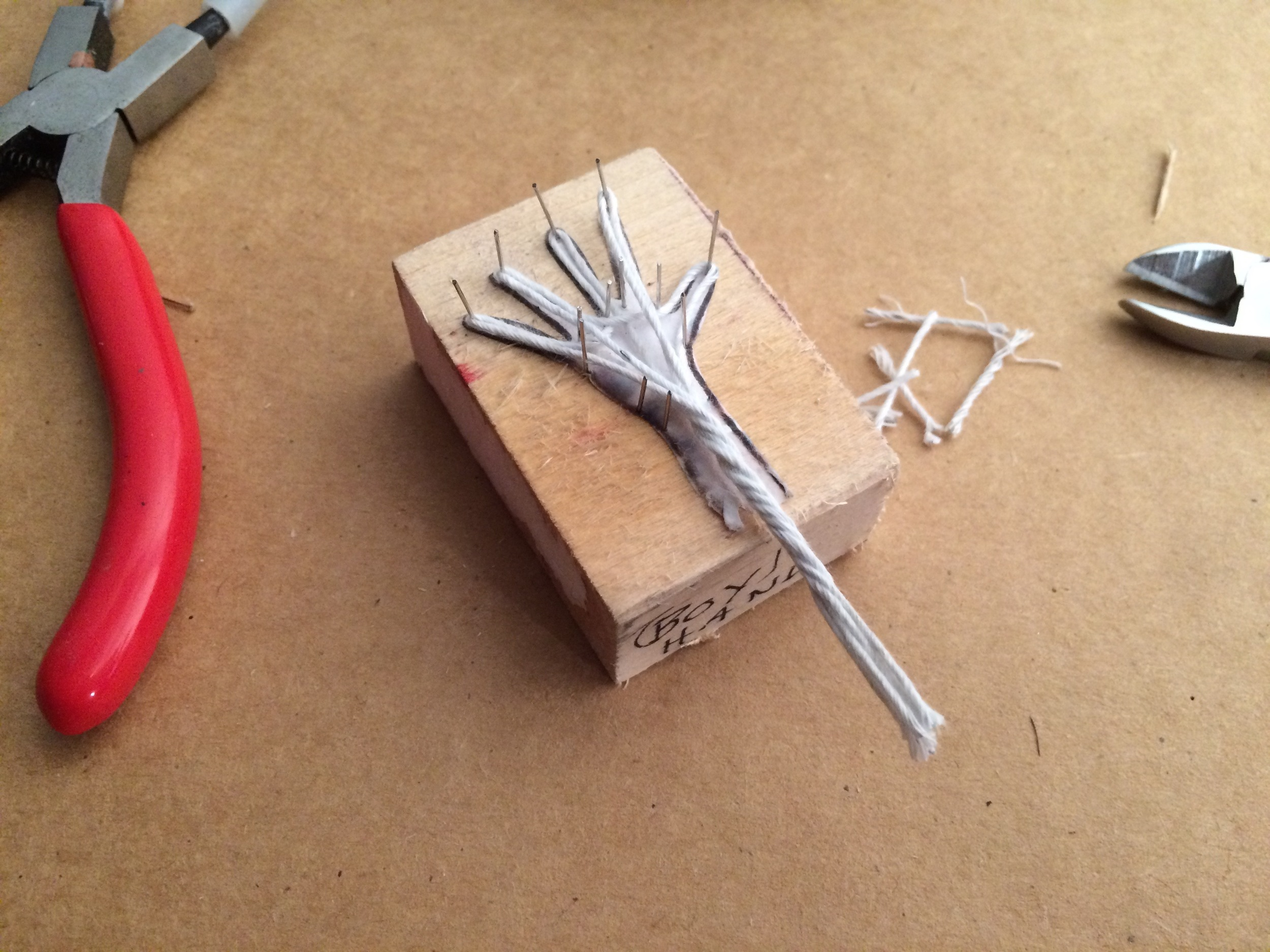 "Miniature hand building is incredibly detailed work, and I've created a ""jig"" to help create consistent hand armatures.  It's based on a tool I saw that helps jewelers to make earrings! It's been a great tool and I've made a jig for each of the characters."