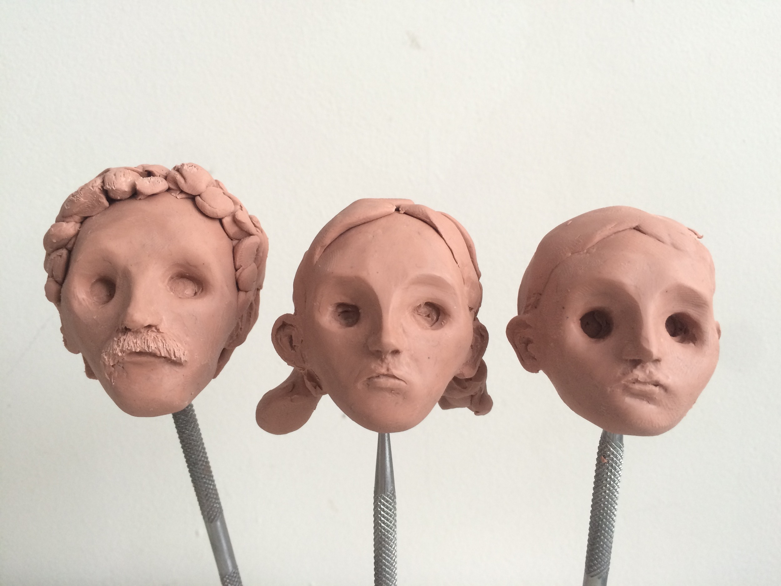 An early version of the heads, the hair is just a sketch of an idea.  The final hair will be made separately and not cast in plastic.