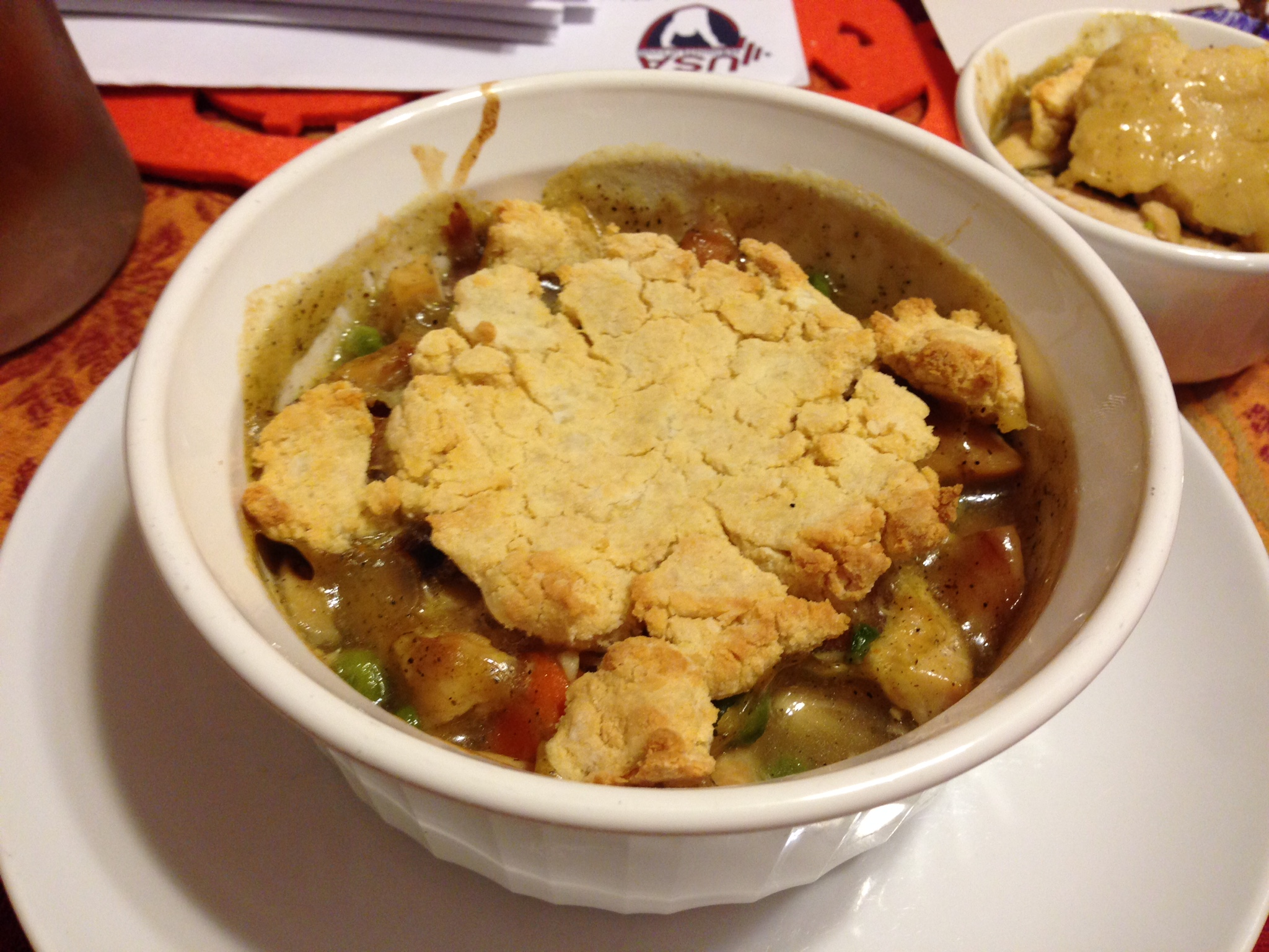 THIS Paleo Chicken Pot Pie is unreal. The small dish in the background was after Duke looked under the crust and rejected it. So, I ate that one, too.