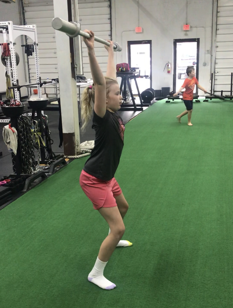 The catch position for the snatch requires overhead strength and ability to stabilize the whole body.