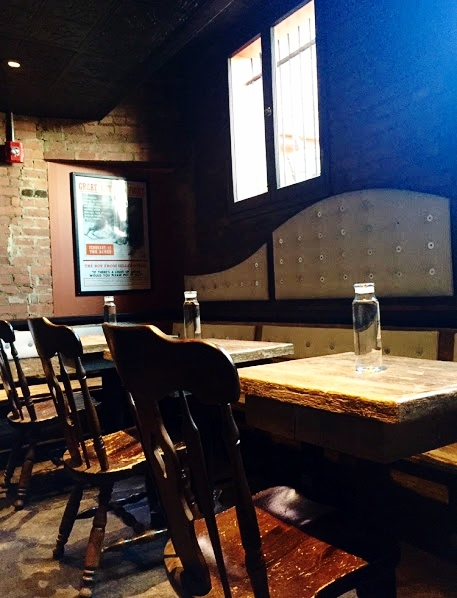 Tables at the Spotted Owl crafted from three hundred year old barn wood flooring.