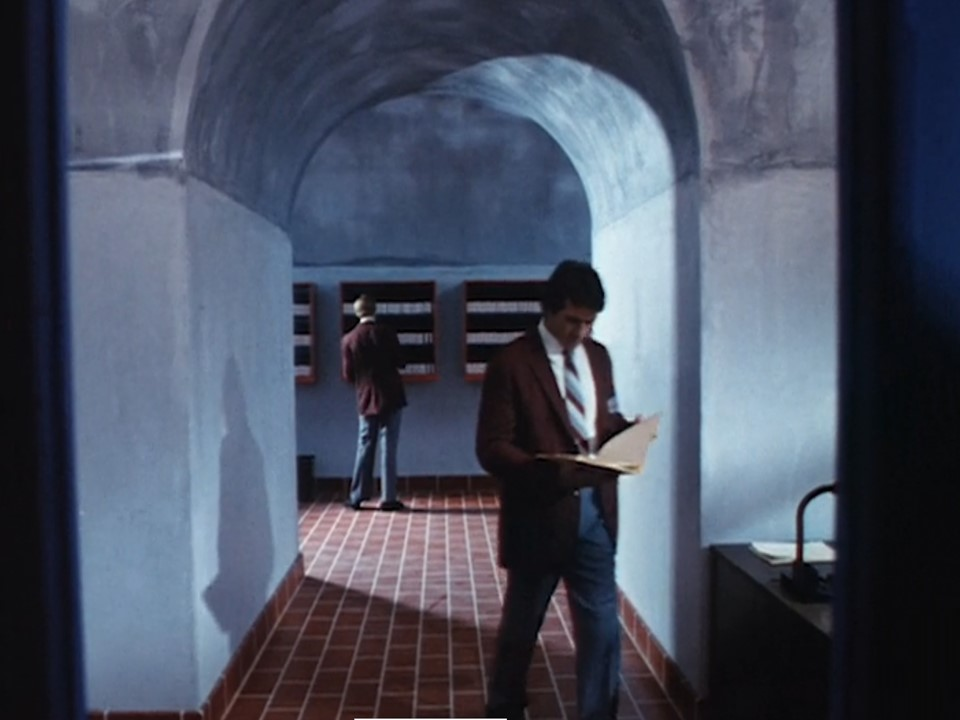 Valets filing VHS tapes in the bathhouse
