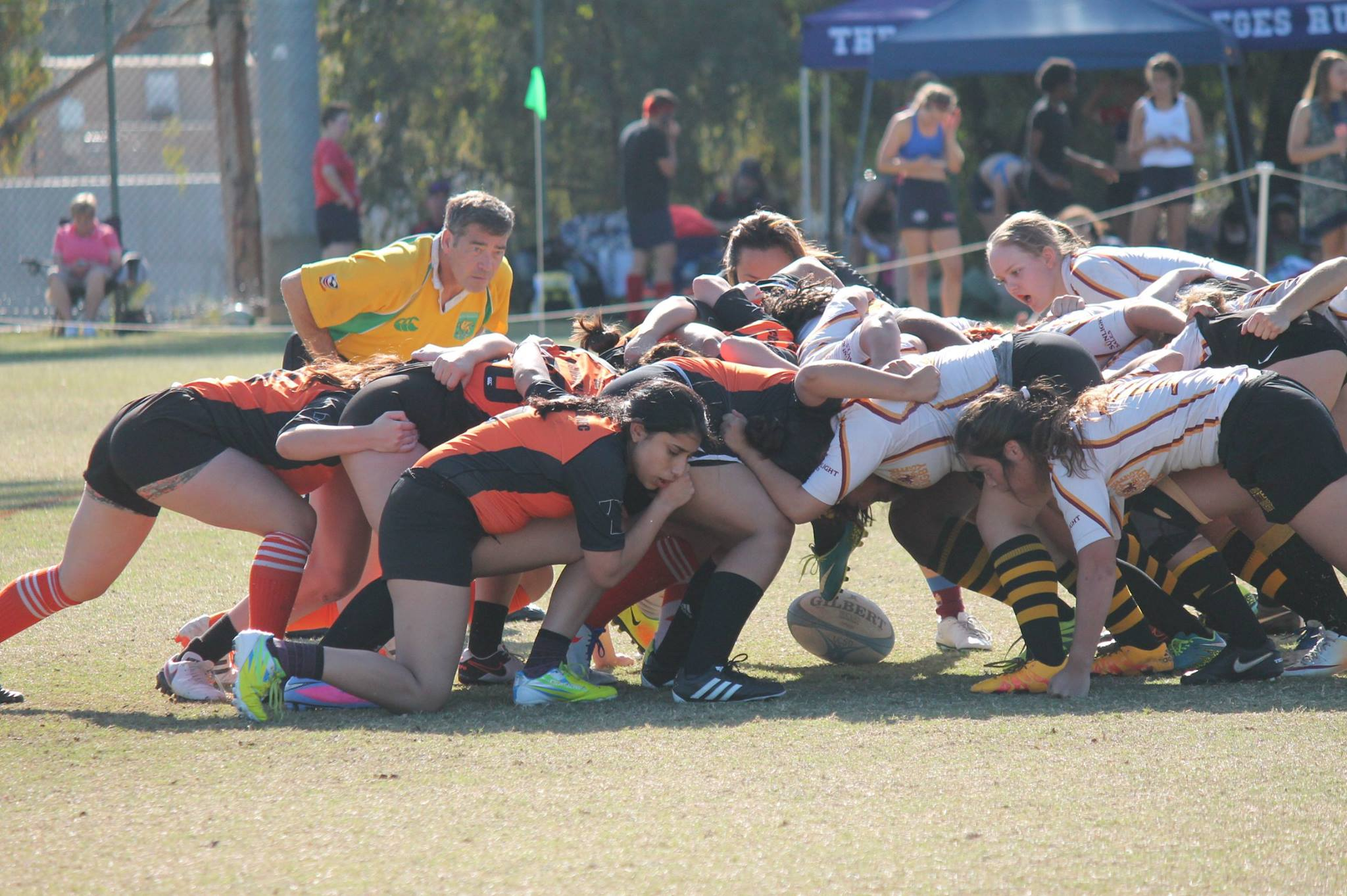 The Occident College Women's Rugby Club (in Orange and black) aka Black Shirts