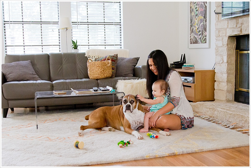 mom, baby, and family dog playing on floor | lifestyle family photography in Cedar Park, Texas | Jason & Melaina Photography