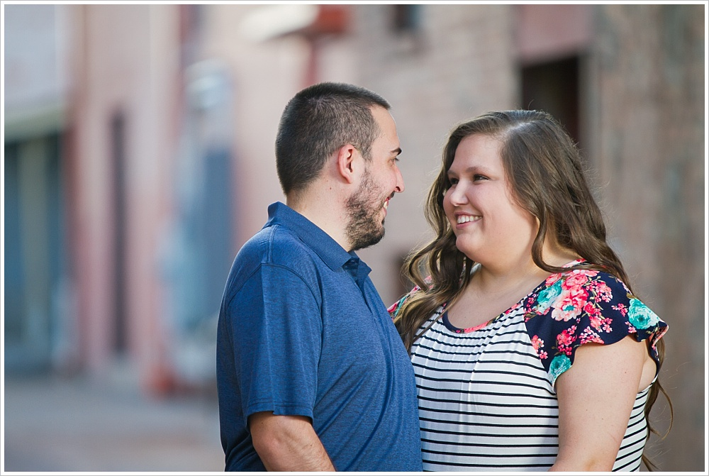 woman and man smile at one another | alley in downtown Waco, Texas | Jason & Melaina Photography