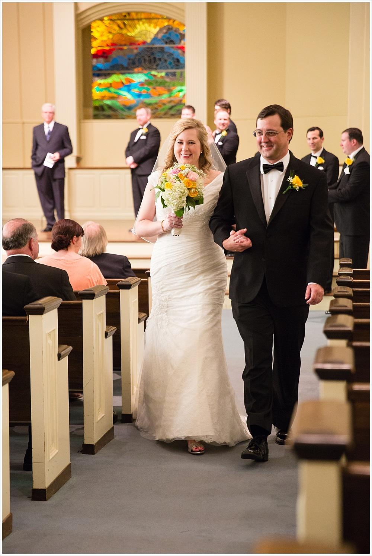 bride and groom walk up the aisle | Calvary Baptist Church, Waco, TX | Jason & Melaina Photography
