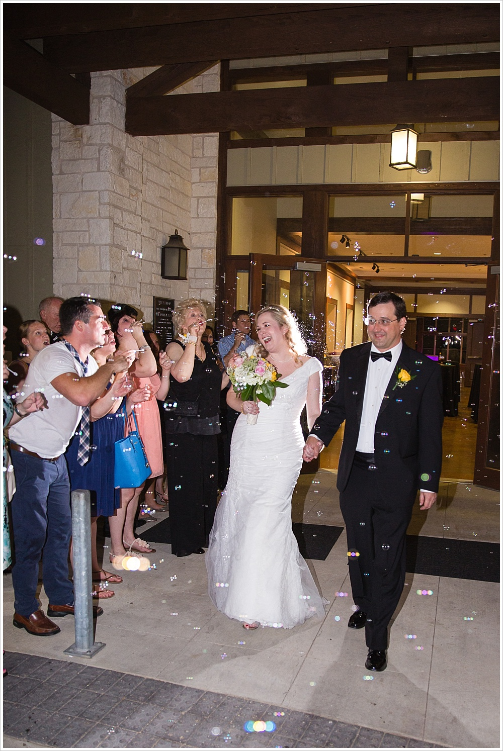 bubble exit as bride and groom leave | Carleen Bright Arboretum, Woodway, Texas | Jason & Melaina Photography