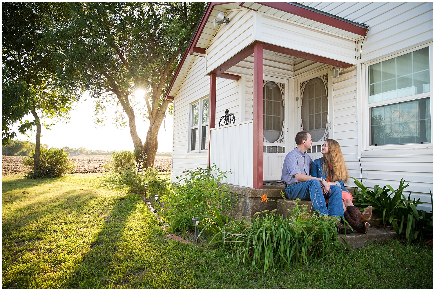 a couple holds each other on front porch steps | West, Texas Engagement Portraits | Jason & Melaina Photography