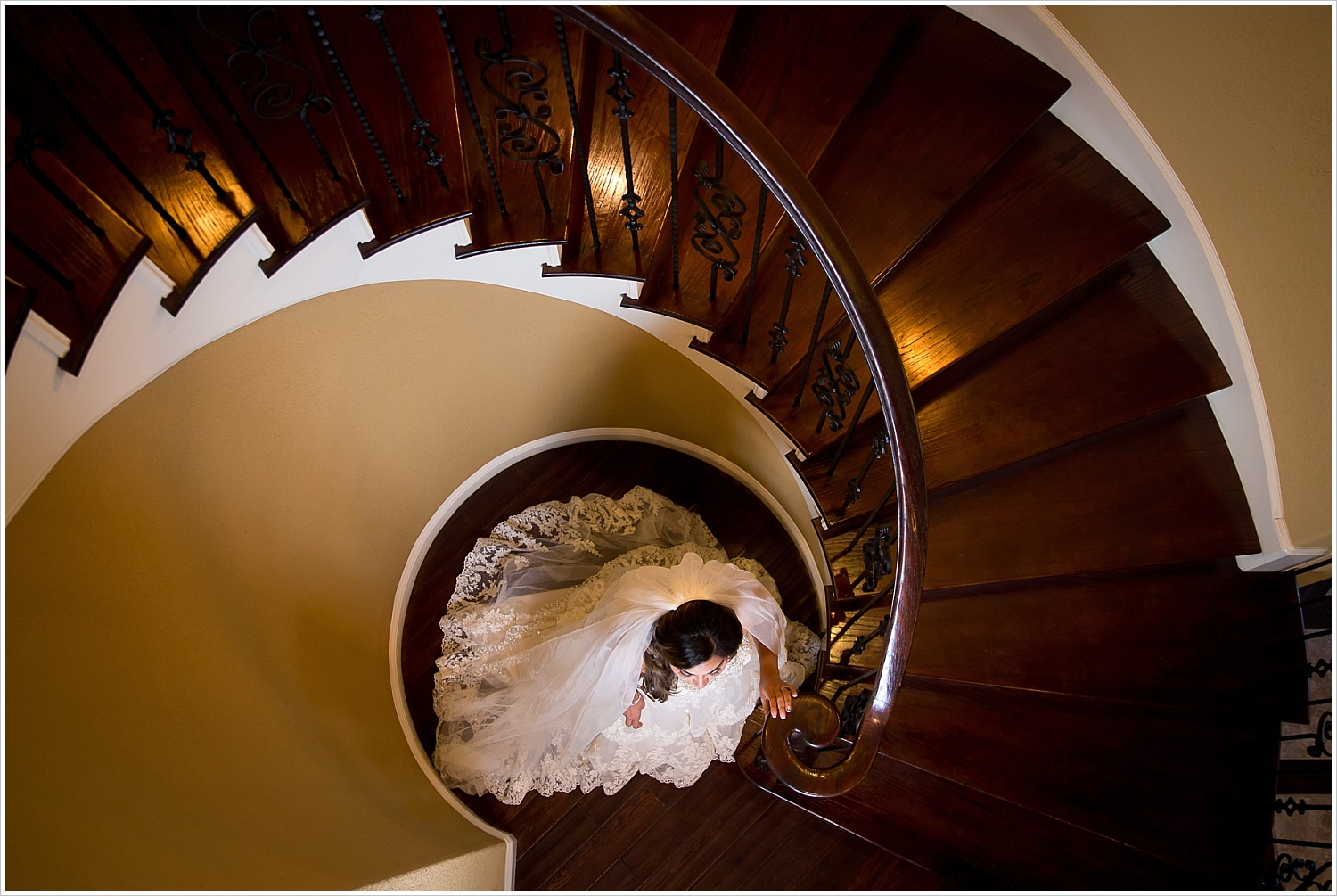 bride at base of spiral staircase | Vera Estates in China Springs, Texas | Jason & Melaina Photography