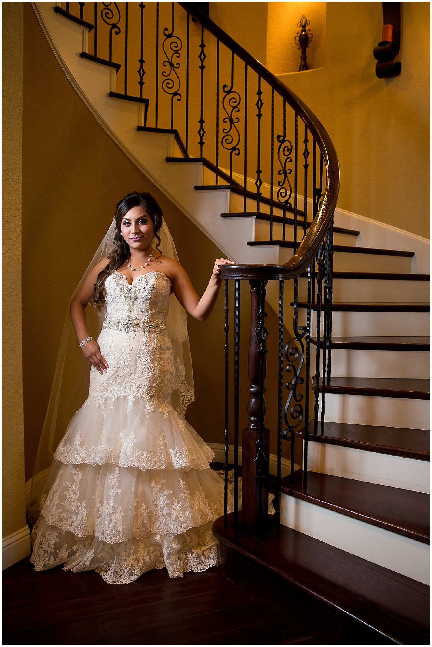 bride next to spiral staircase | Vera Estates in China Springs, Texas | Jason & Melaina Photography
