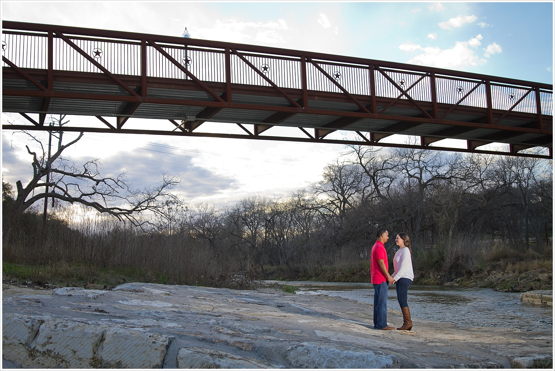 Couple under walking bridge with open sky