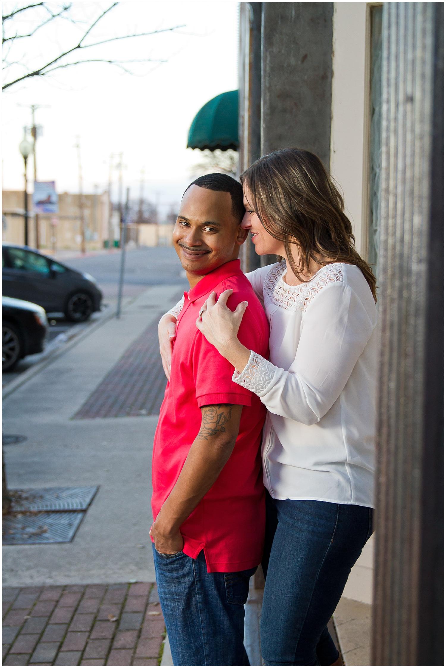 Couple embrace on sidewalk in downtown Belton, Texas