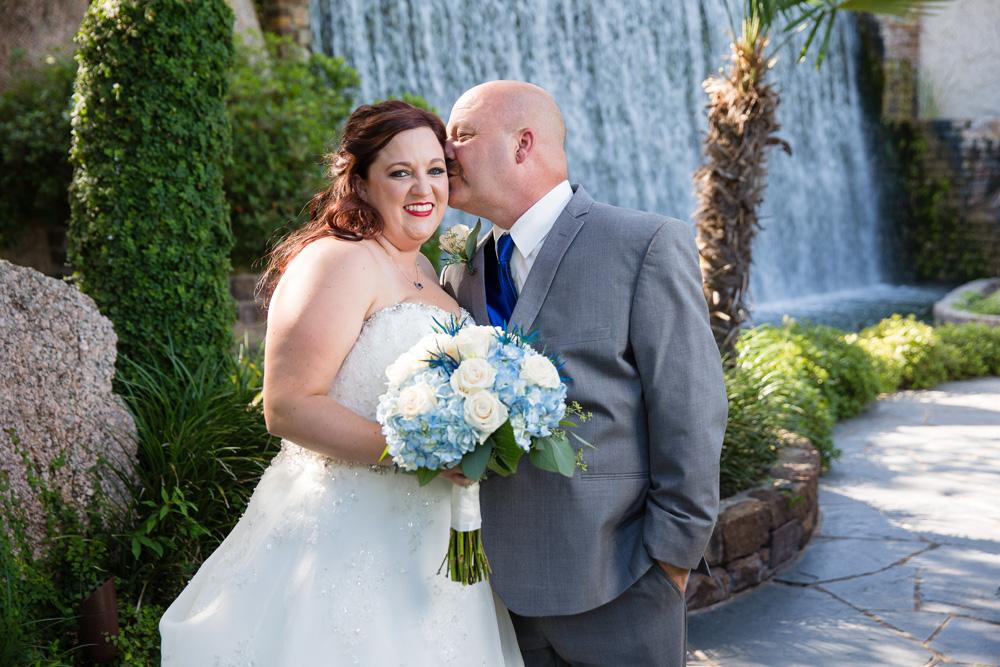 Groom kisses bride at Horseshoe Bay resort wedding