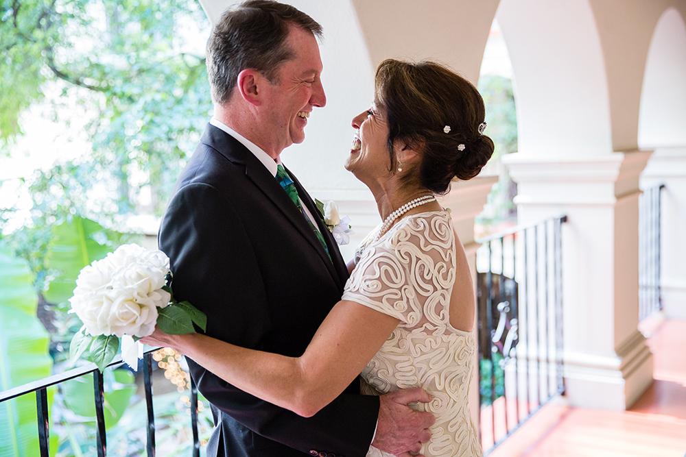 Bride and groom embrace at first look before San Antonio Riverwalk wedding