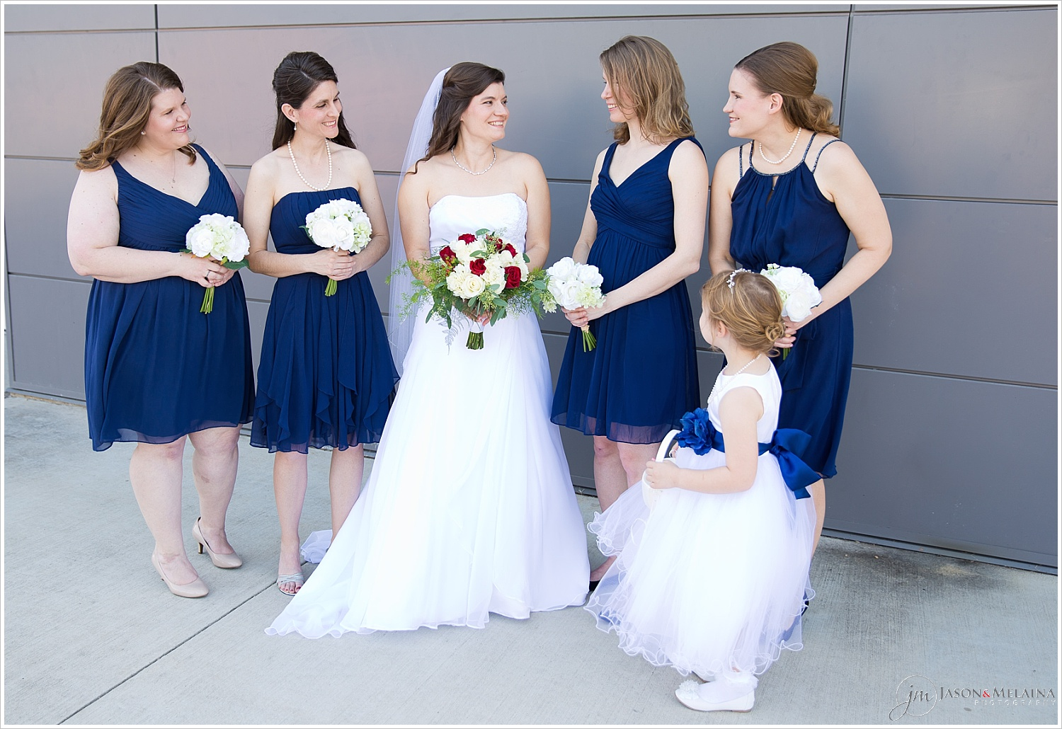 Bridal party pose outside Antioch Community Church in Waco, Texas