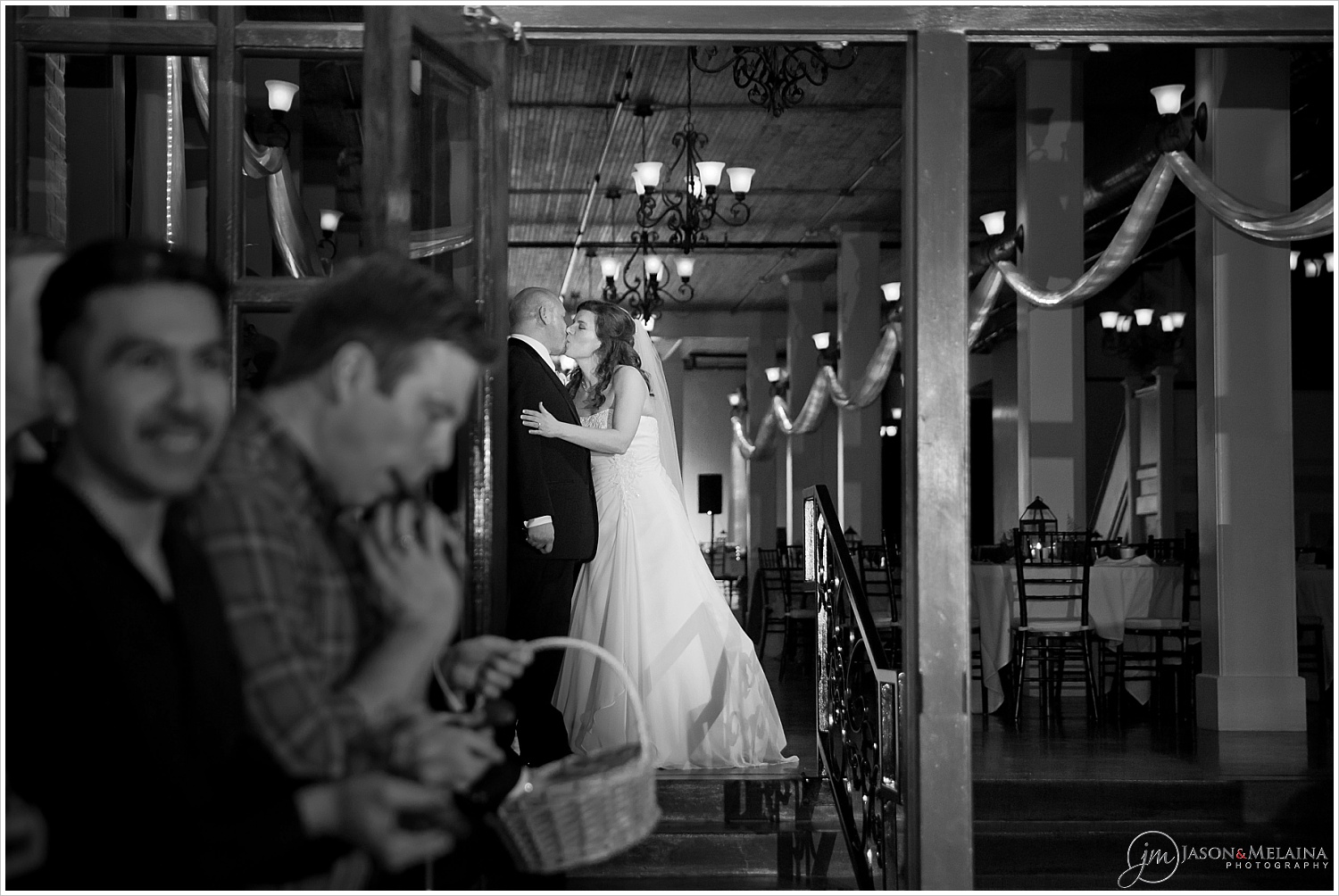 Bride and groom kiss before leaving their reception, The Palladium, Waco, Texas