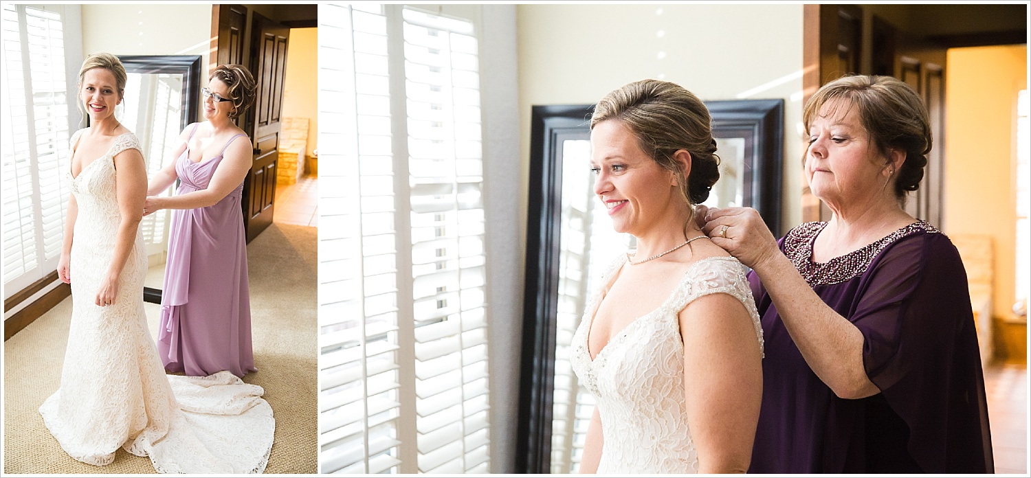 Mother of the bride and sister help bride finish getting in her wedding gown
