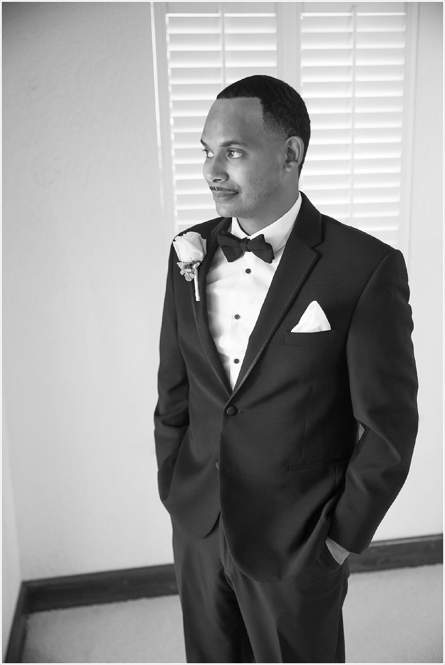Groom in groom's suite at La Rio Mansion