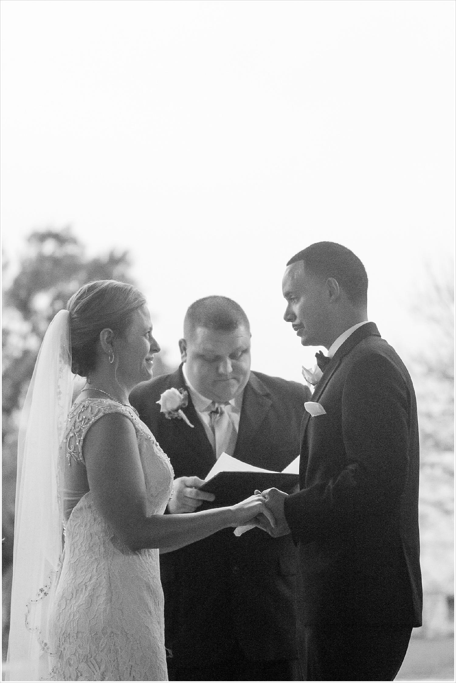 Bride and groom exchange vows at rainy wedding ceremony at La Rio Mansion