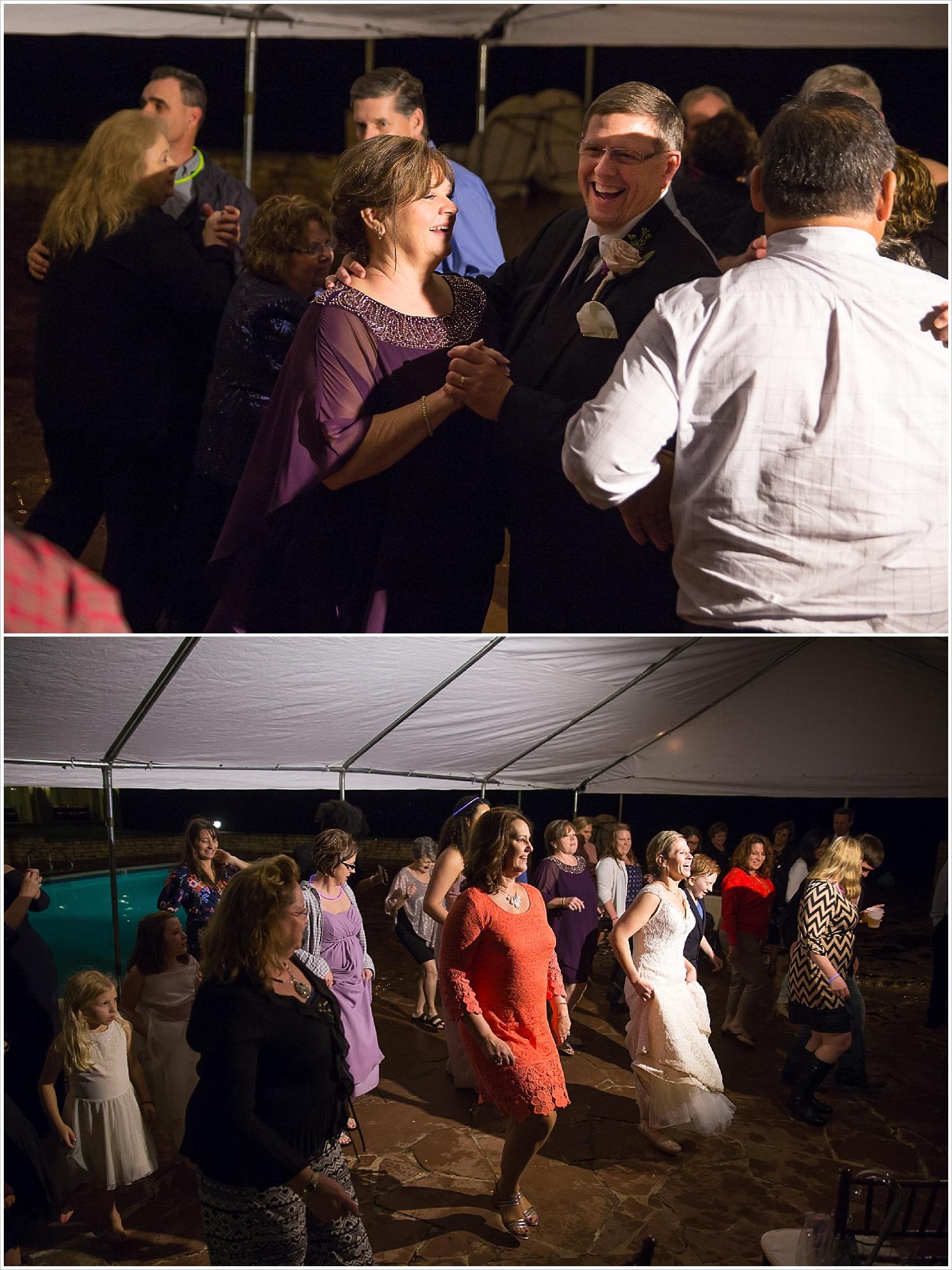 Dancing at rainy wedding reception at La Rio Mansion